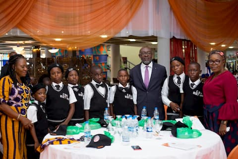 Mr. Ime Udoetuk and the students of his adopted school CSC Ikot Ubo