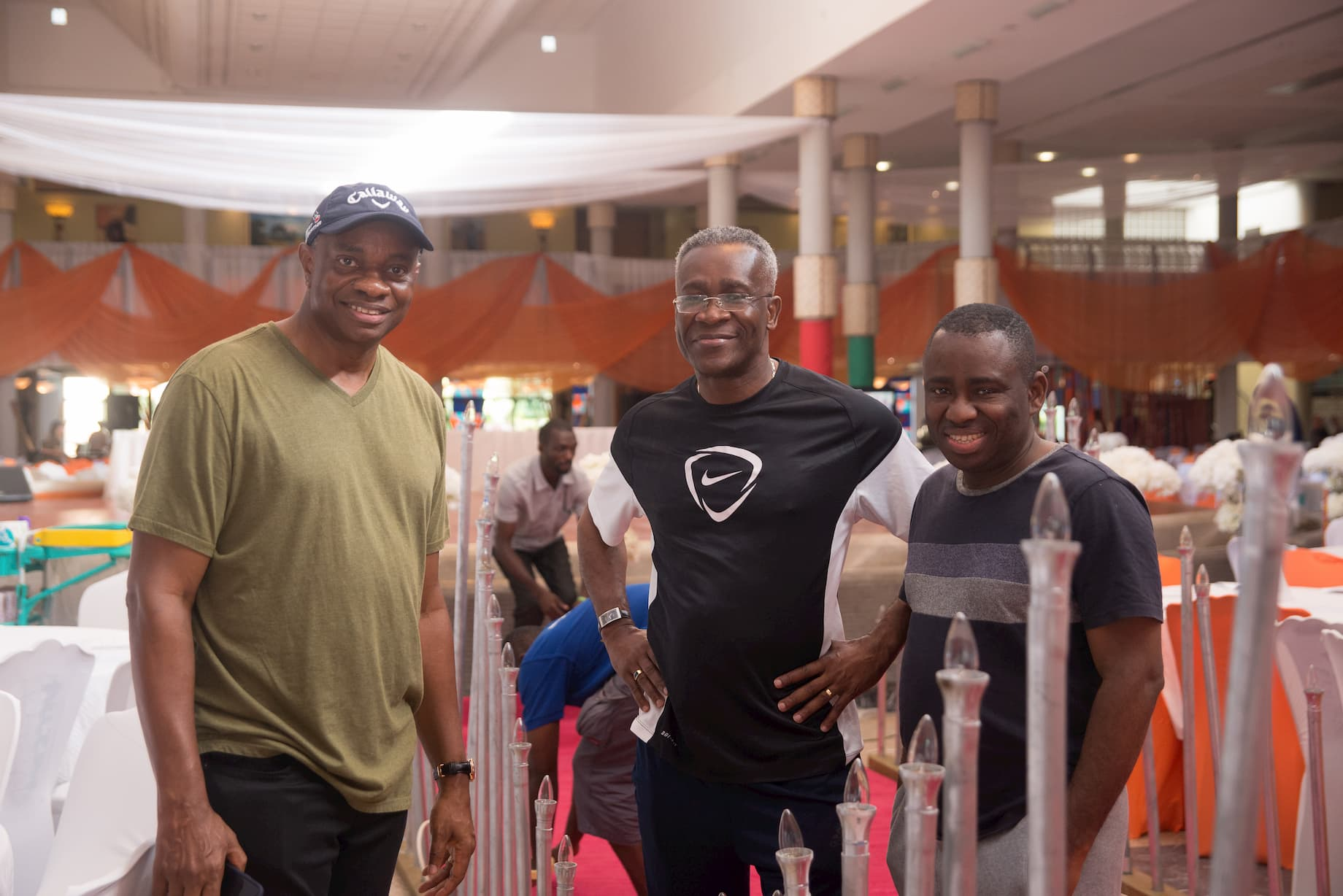 Mr. Inoyo, Mr. Aniekan Etiebiet & Dr. George Akpan before the event, helping to set up