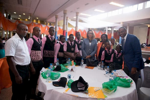 Mr. Inoyo Right and the mentor Imeh Okon- 4th right with the students of her adopted school Eastern Nsit Sec. Sch, Odot