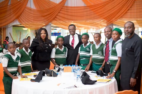 Mrs Idong Etiebiet 3rd Left with the Hon Com for Education and the students of her adopted school