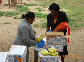 Mrs. Victoria Charles and Prof. Uduak Esshiet packing christmas food for the CCC Christmas party
