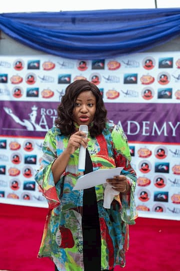 Mrs Imo Bassey giving a speech onbehalf of The Secretary of the Board of Trustees ITF Dr George Akpan at the opening of the Academy in Uyo